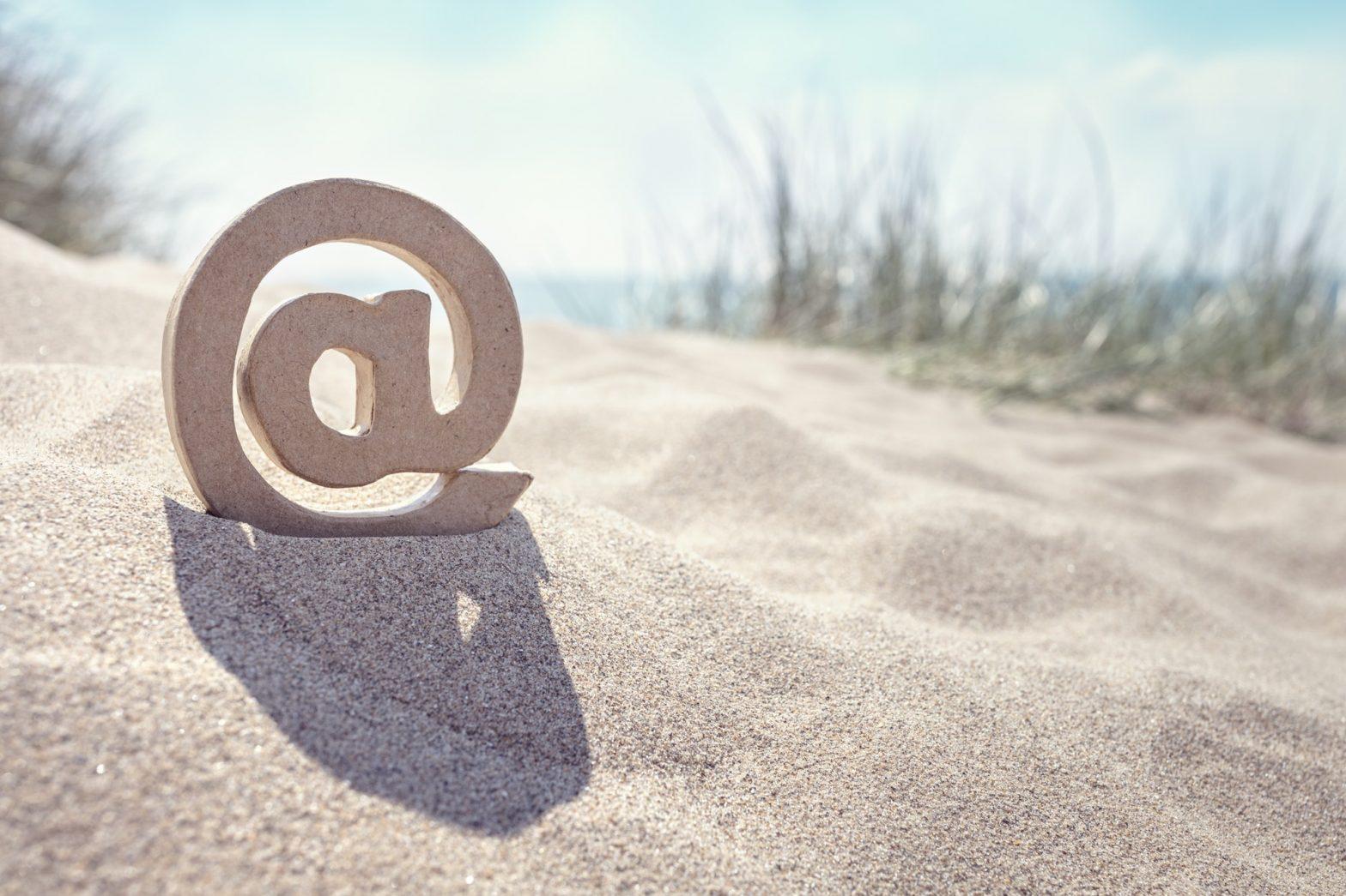 E-mail @ symbol at the beach